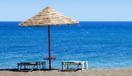 Sunbeds & umbrella on Galissas sandy beach near Dolphin Bay Family Resort Hotel in Syros
