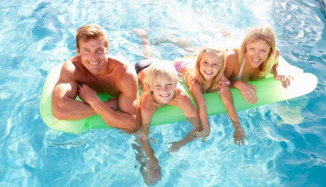 Parents & kids enjoy the family hotel pool facilities at Dolphin Bay Beach Resort in Galissas, Syros