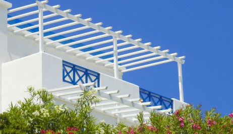 White & blue painted balcony at Dolphin Bay Family Beach Resort Hotel in Galissas, Syros