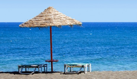 Sunbeds & umbrella on Galissas sandy beach near Dolphin Bay Family Resort Hotel in Syros